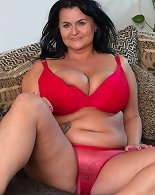 Hot mature lady with huge natural breasts getting naughty
