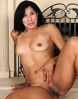 Exotic 44 year old Estrella Jane slips off her dress