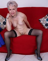 Mature lady Sextasy getting naked for some fun