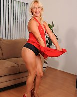 Milf Andi Roxxx teases and shows off her alluring black bra and pantie set