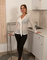 Naughty unshaved housewife getting wet in her kitchen