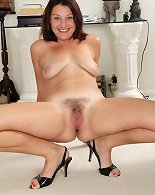 Hairy housewife Ava Austin exposes her big natural breasts.y